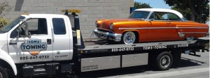antique car towing vintage lincoln